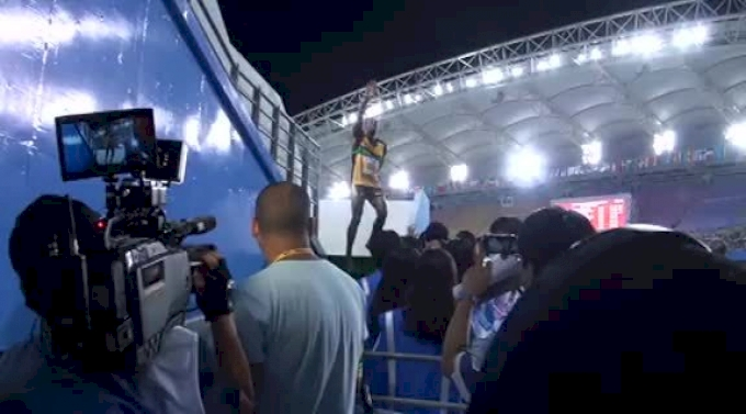 Usain Bolt talks to media after easily making 200 finals at Daegu 2011 World Track Championships
