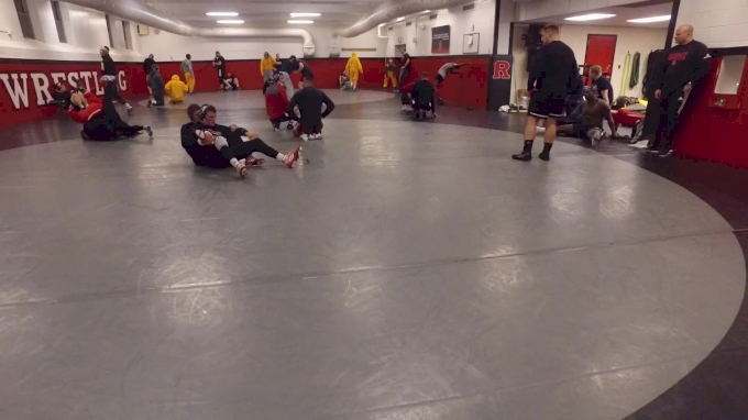 Rutgers And Iowa Warming Up Along Side Each Other